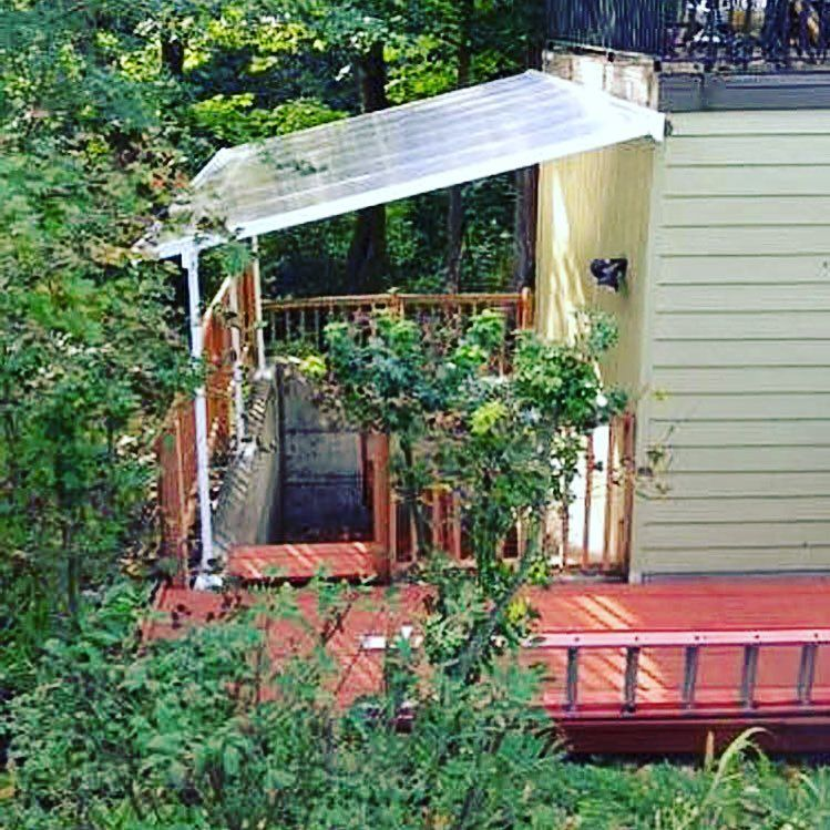 A Feria Patio Cover Used As Rain Shelter Over An Outside Basement