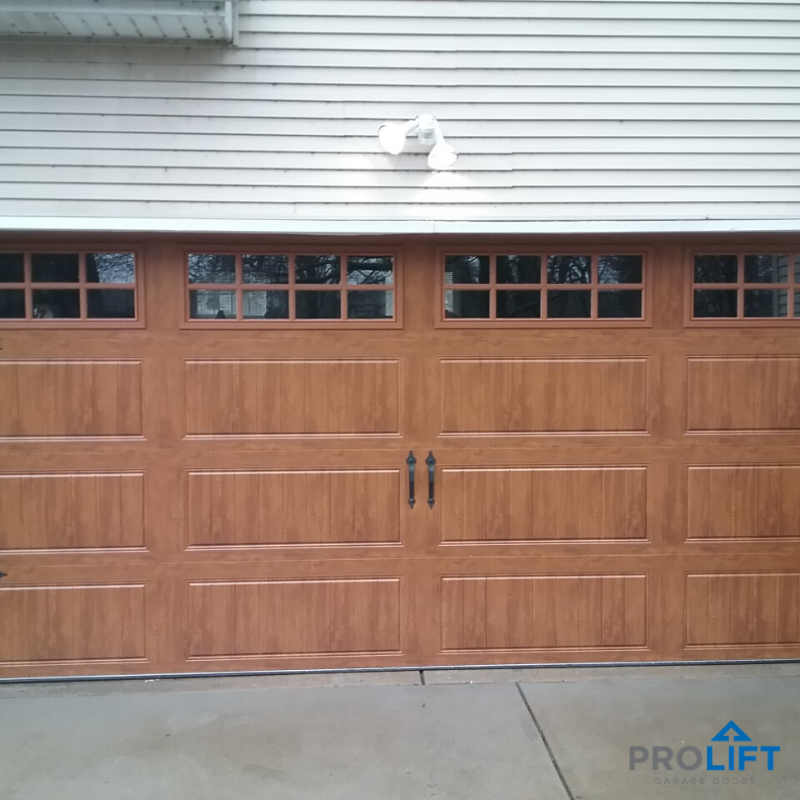 Garage Doors For Homeowners Get The Look You Want Garage Door Styles Faux Wood Garage Door Garage Doors