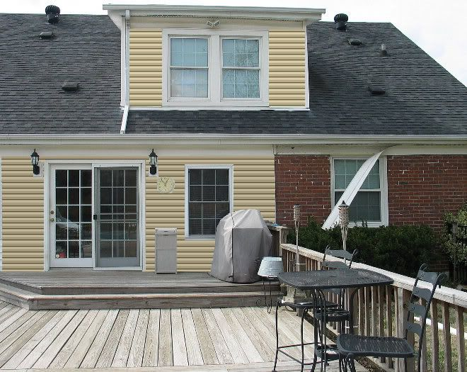 Yellow Siding With Red Brick House Exterior Color