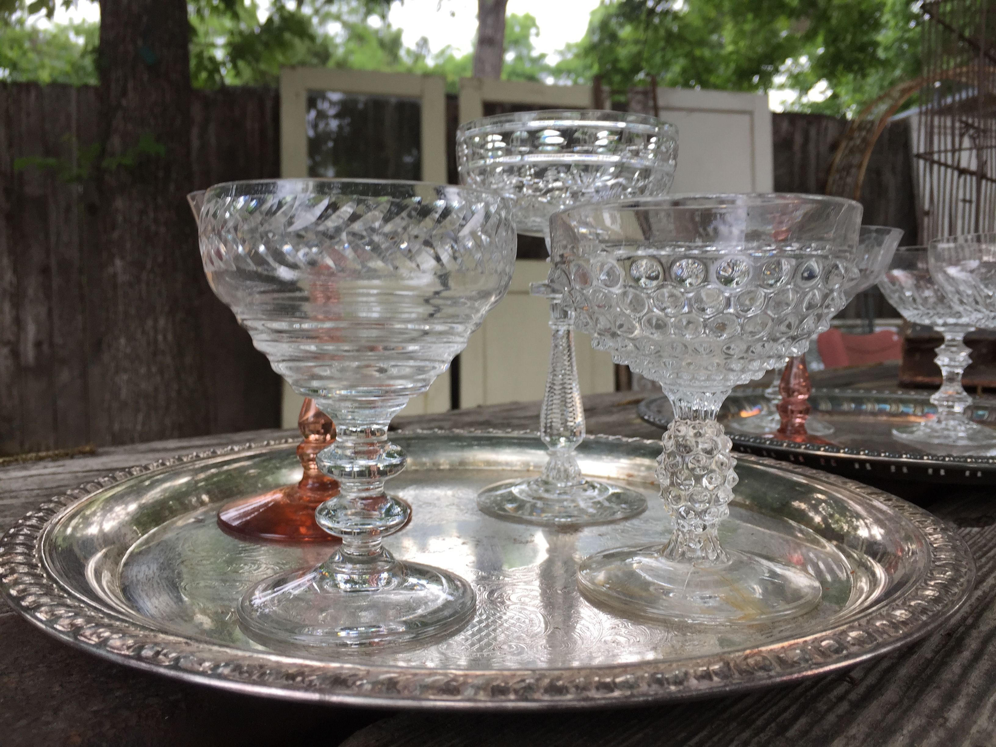vintage coupe's at your wedding or special event...vintage multi-colored goblets.. photo: mint-2-be... Mintage Rentals provides modern + vintage rentals for staging and special events.