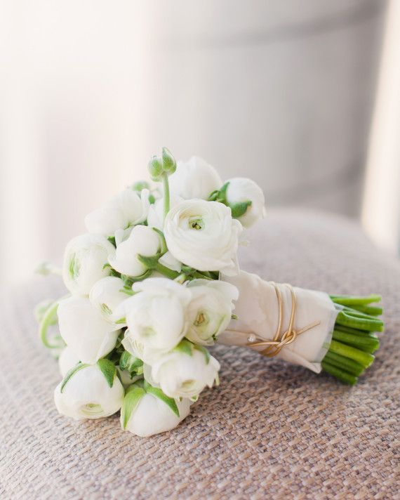 The bridal bouquet consisted of white ranunculus and was finished with gold cord around the stems.
