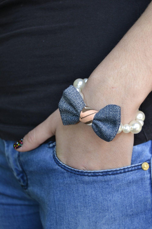 pearl bracelet with modern twist tie jeans