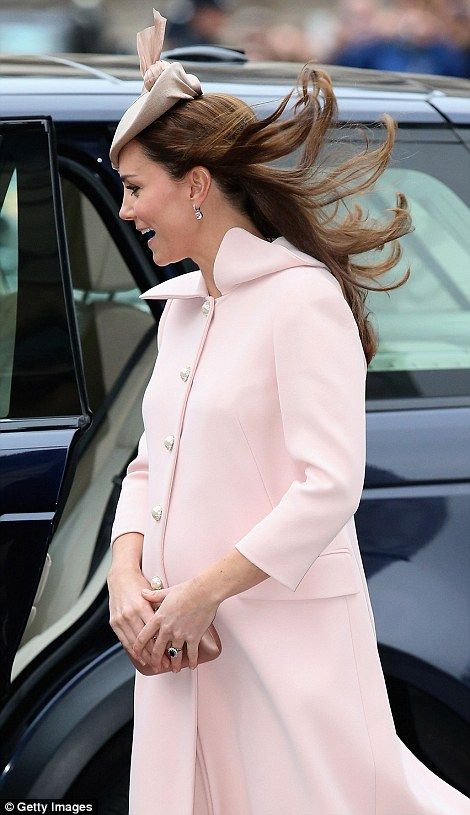 Breezy: The March wind played havoc with the Duchess of Cambridge's hair as she made her w...