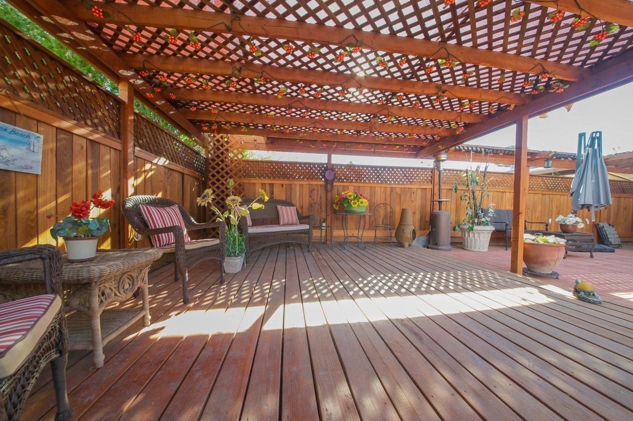 Wood deck with covered entertainment space.
