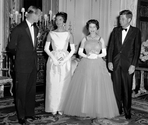 Prince Phillip, Duke of Edinburgh talks with First Lady Jacqueline Kennedy in 1961 while HM Queen Elizabeth II and President Kennedy watch.