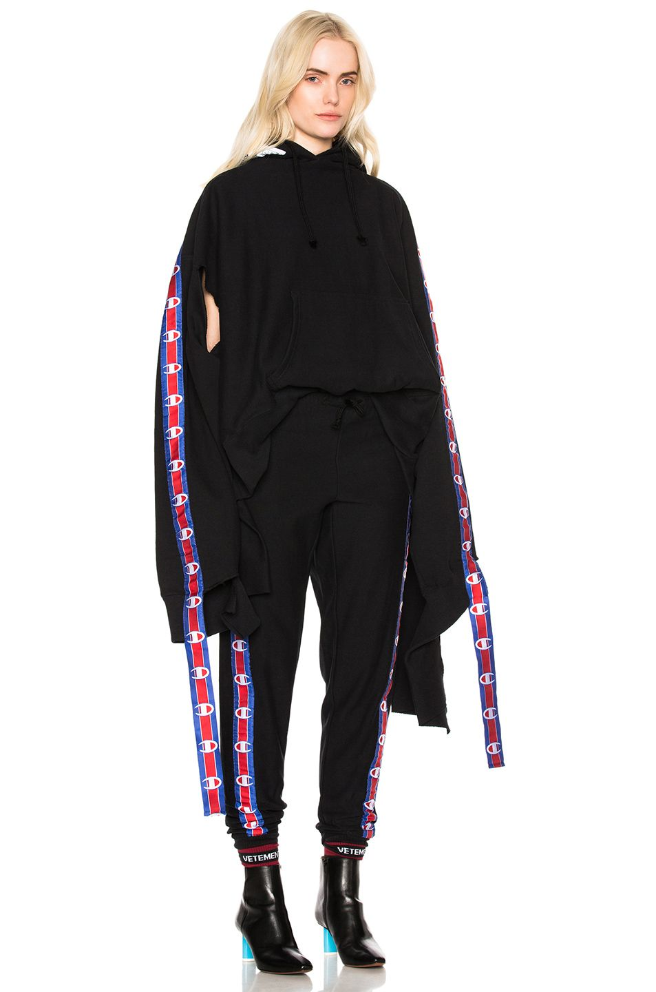 dd94d7693522 Image 1 of VETEMENTS x Champion In Progress Hoodie with Tape in Black