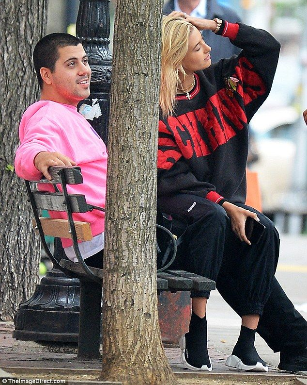 On his lap: Hailey Baldwin made herself comfortable with a dark-haired fellow in NYC on Mo...