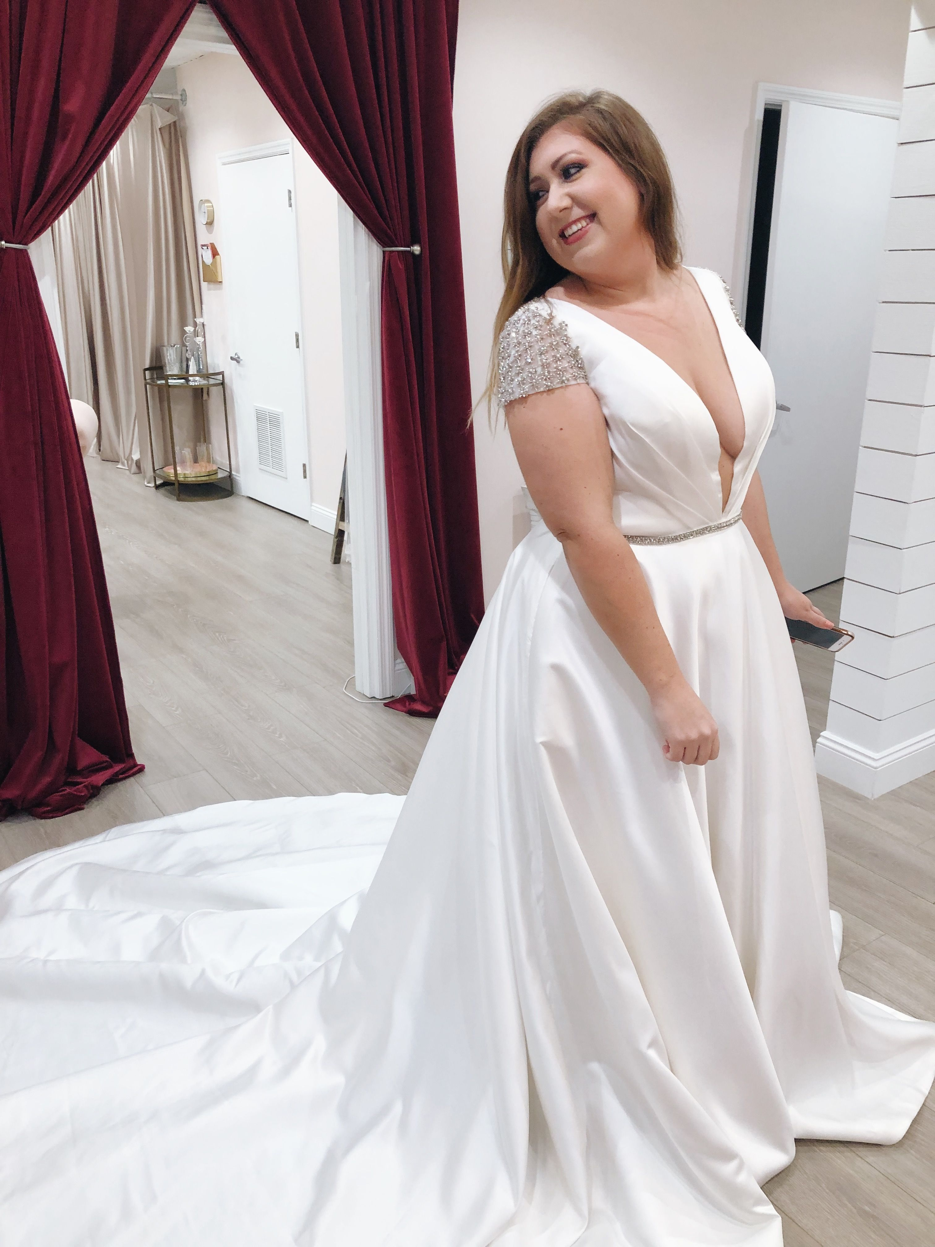 Happy Bride In A Breathtaking Plus Size Gown With Plunging Neckline Make An Appointment At Fernandina Plunging Neckline Wedding Dress Plus Size Gowns Dresses [ 4032 x 3024 Pixel ]