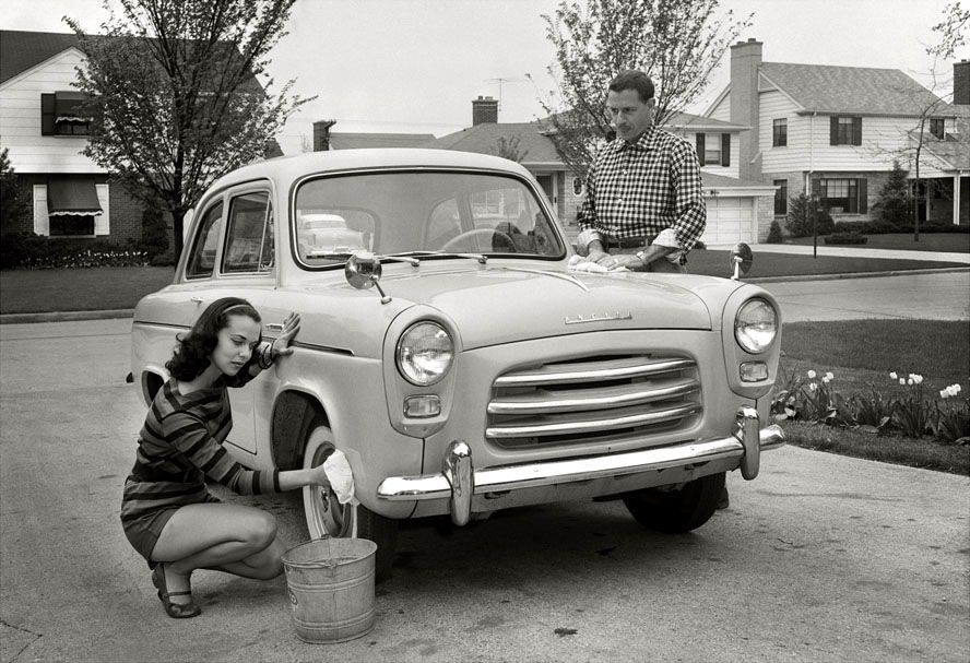Washing a Ford Anglia in Chicago, Illinois, 1957. Old