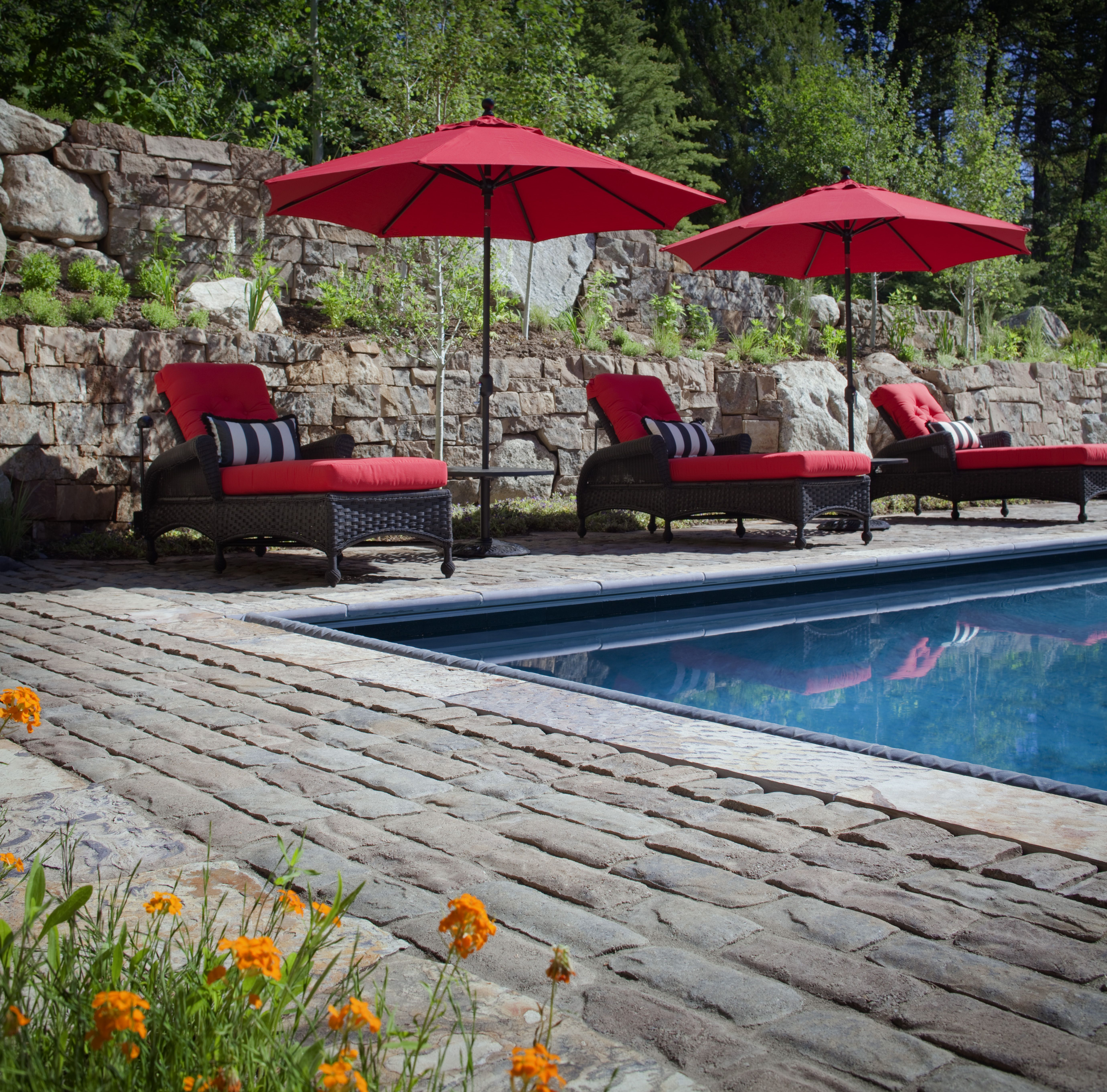 pavers around pools are the perfect performer, providing a
