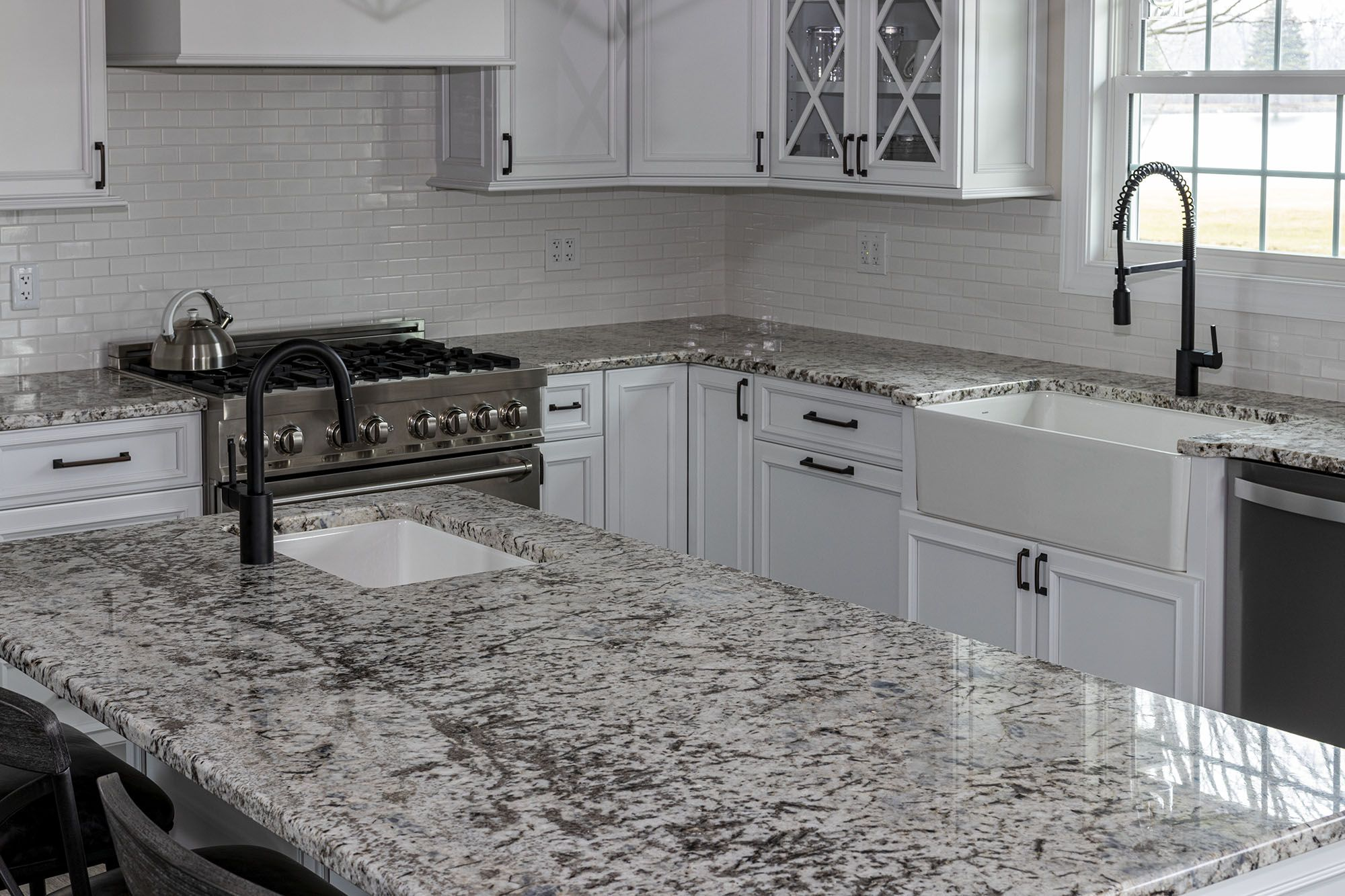 White Kitchen With Speckled Pearl Granite Countertops White Granite Kitchen Granite Countertops Countertops