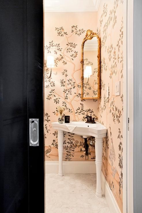 Website Picture Gallery Clad in pink chinoiserie wallpaper this beautiful bathroom features a corner Parisian pedestal sink accented