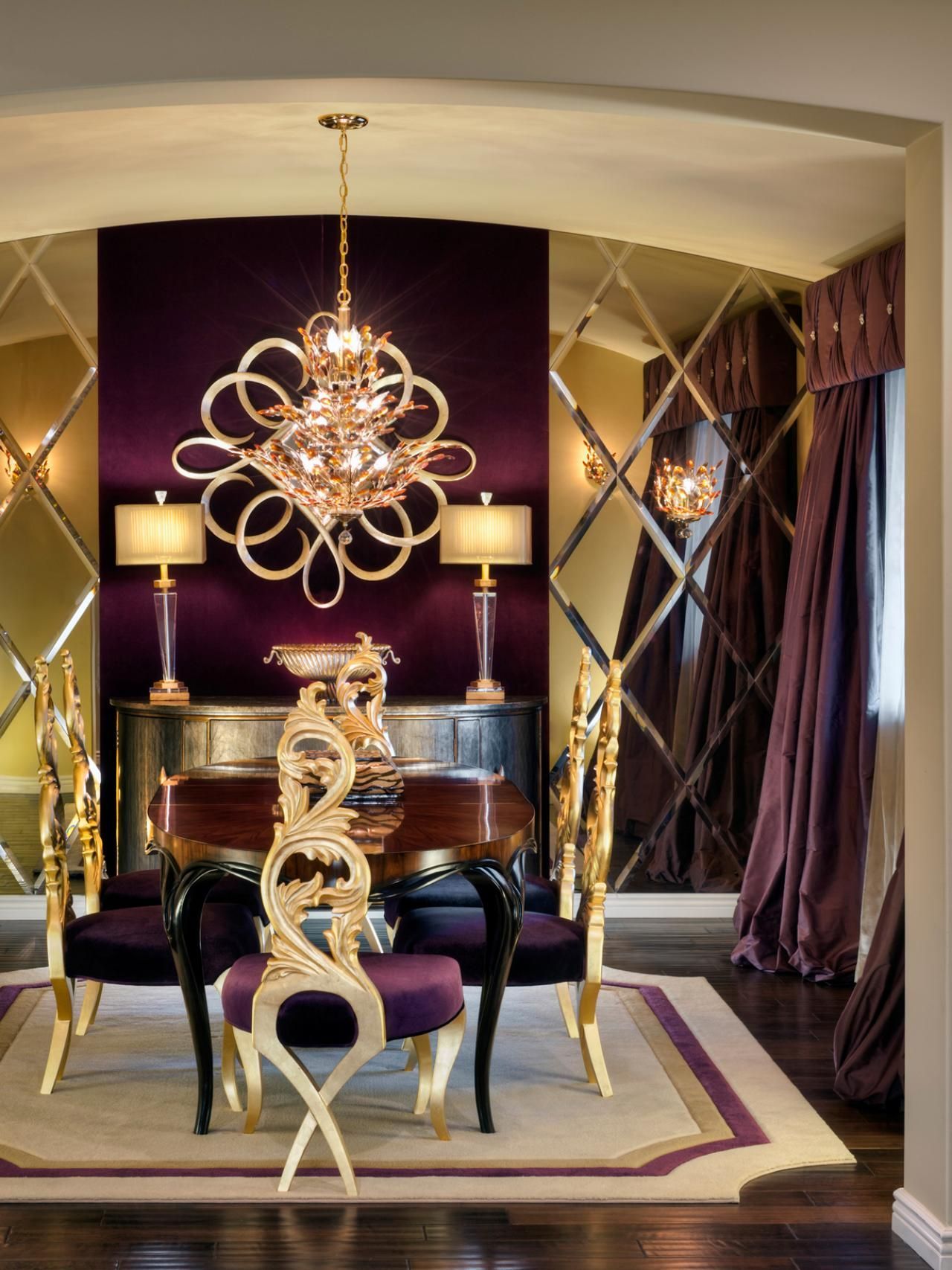 This opulent dining room incorporates purple and gold accents in its