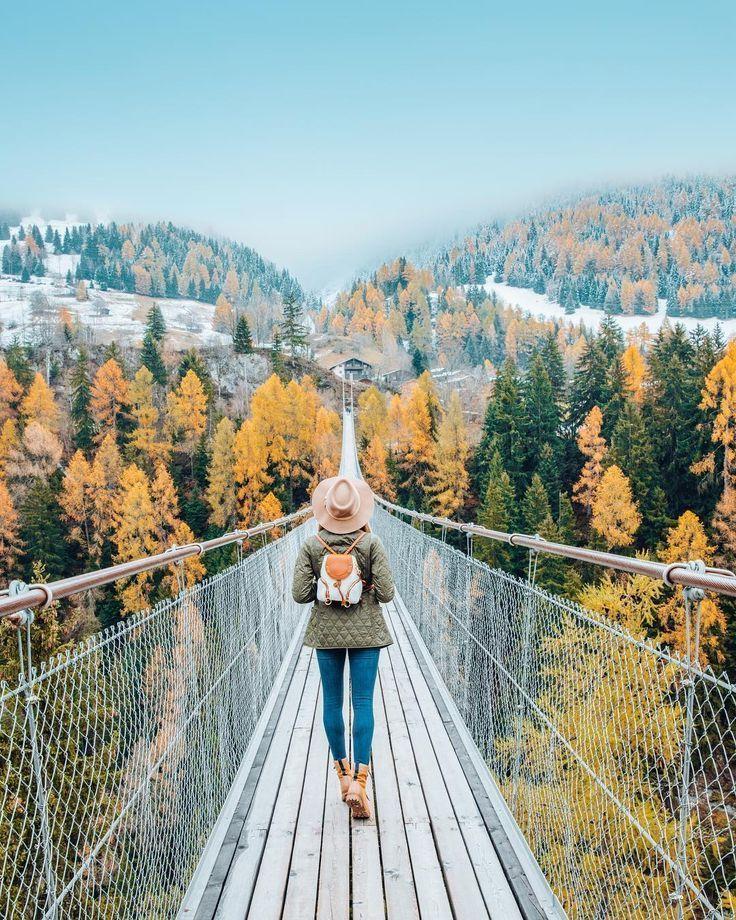 Walking over Switzerlands suspension bridge in Autumn