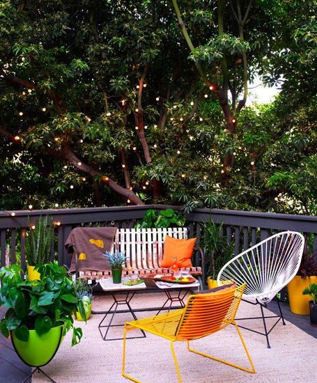 Iove this combination of chairs! and being surrounded by big trees. want a porch/deck like this. one day.