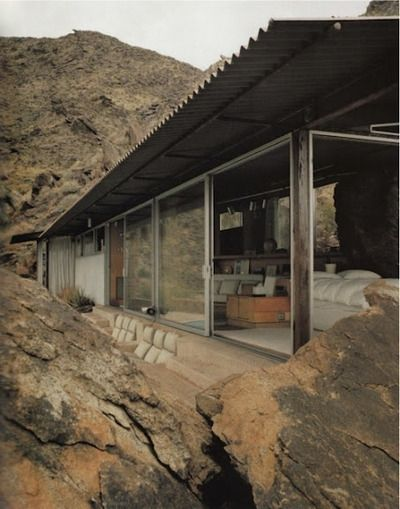 Neutral Tones, Tin Roofing, Large Windows and Boulders.