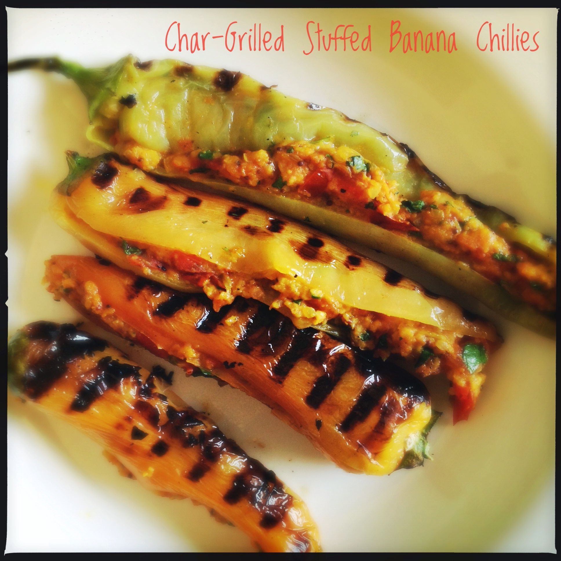 Char Grilled Banana Chillies Stuffed With Tomatoes And Spices Bharwan Mirch Grilled Bananas Stuffed Banana Peppers Stuffed Peppers