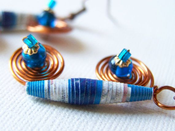 Beads handmade paper and varnished for durability, seed beads, glass beads, copper wire and brass fittings and gold plated  Length 3 cm