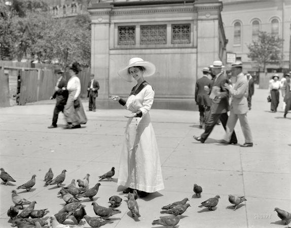 Boston, 1915. Feeding the pigeons in Boston common.