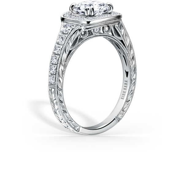 This elegant design is a halo engagement ring from the Carmella collection. It features 0.43 ctw of diamonds. The signature handcrafted details include wheat hand engravings, signature filigree, peek-a-boo diamonds and milgrain edging. The center 1 carat round stone (shown) is a customized option.