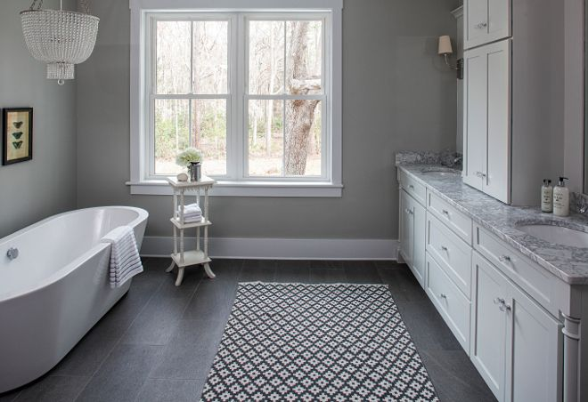 The Master Bathroom Features Grey Walls Painted In Sherwin Williams Aloof Grey And Grey Floor Tile Grey Bathroom Tiles White Master Bathroom Dream Bathrooms