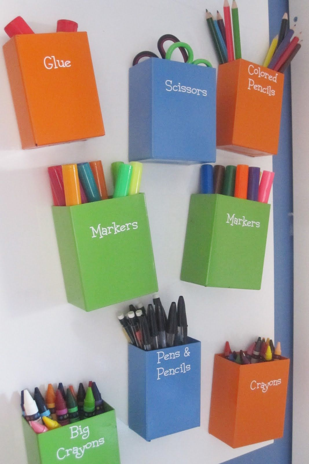 Metal bins covered with vinyl labels placed on a magnetic for Magnetic board for kids ikea