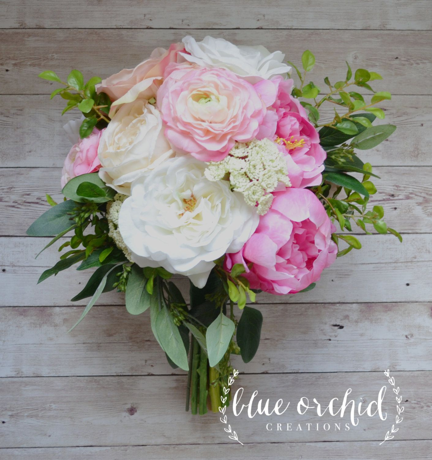 silk wedding bouquet with pink and cream peonies ranunculus cabbage roses garden roses and greenery bridal bouquet