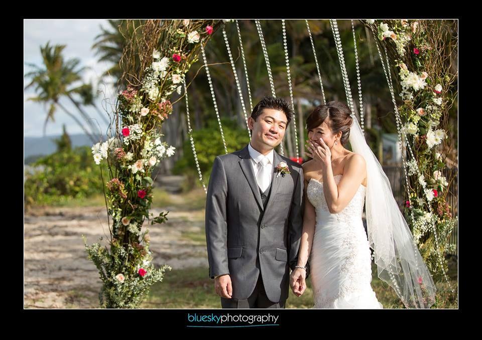 Wedding arch with fresh flowers & garlands