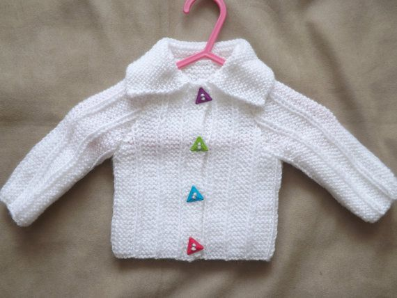 White baby cardigan with mulitcoloured by Vickyannstitches on Etsy, £9.00