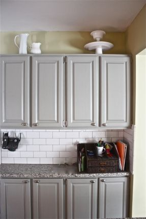 White Subway Tile And Grey Cabinets