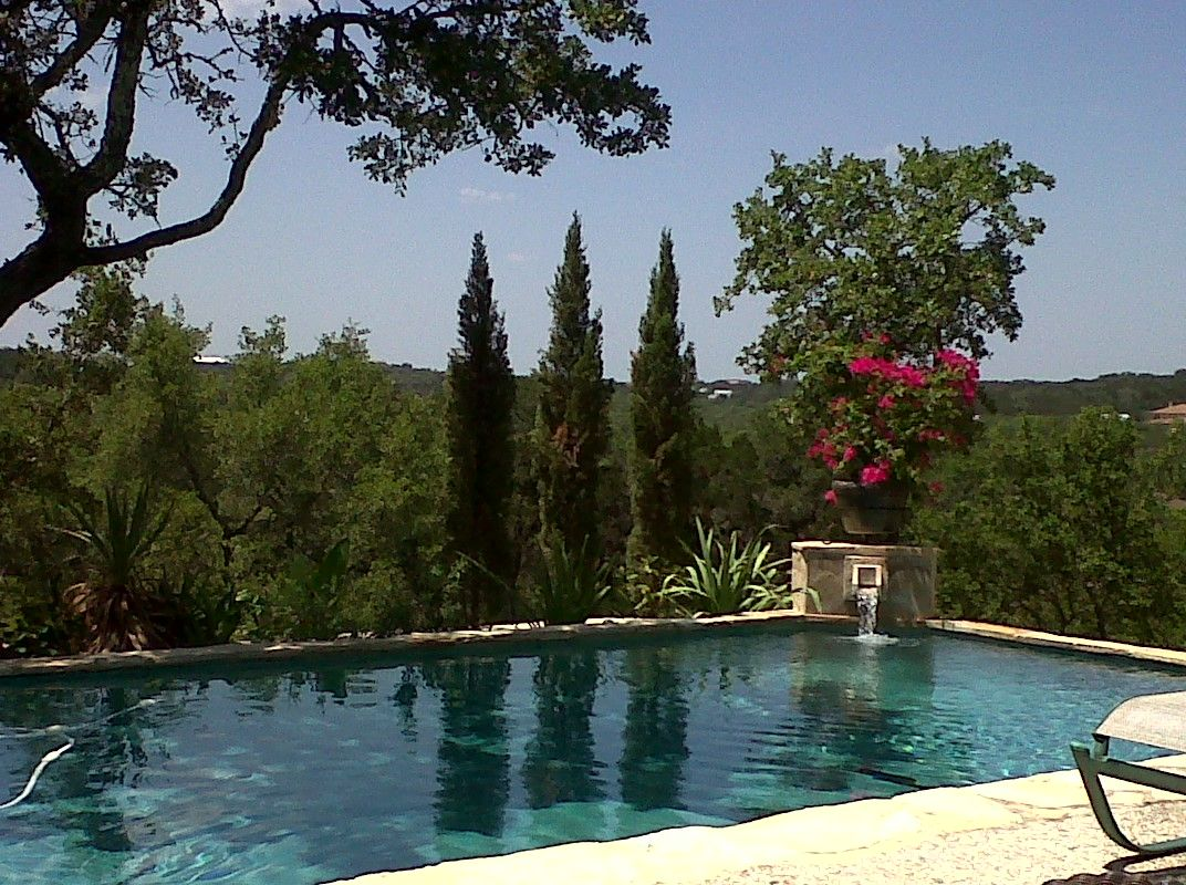 A Little Bit Of Italy With Italian Cypress Trees Adorning