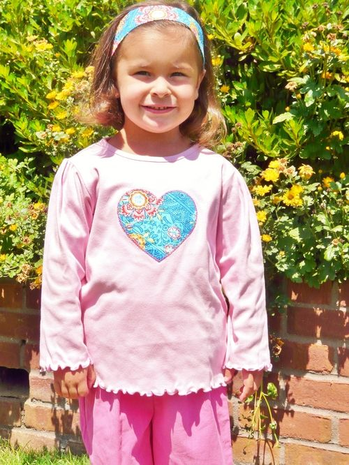 When you love it you have to show it. This Applique Heart Shirt is so cute! Great Colors!  Available at thetravelintrunk.com   enter coupon code: PIN15 at checkout for 15% off your purchase!