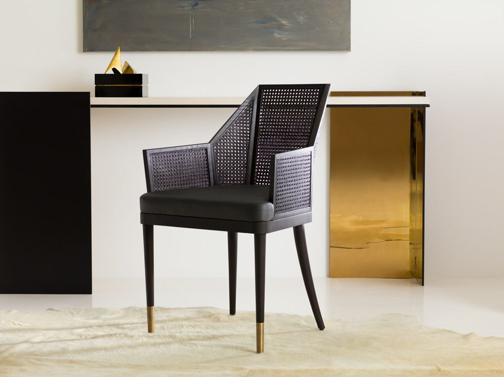 The Cane Arm Chairs utilize traditional caning but keep it modern
