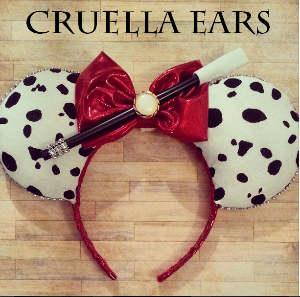 Cruella Villain ears, from 101 Dalmatians. With her signature cigarette holder and sparkly headband, metallic bow and rhinestones trim on holder and edges. Comfortable headband and an excellent support on ears. Made to last, offering Free Shipping from now-January 5th 2015