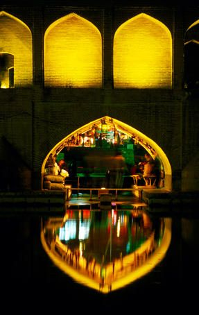 Teahouse under arch of Si-o-Seh Bridge reflected in Zayandeh River, Esfahan