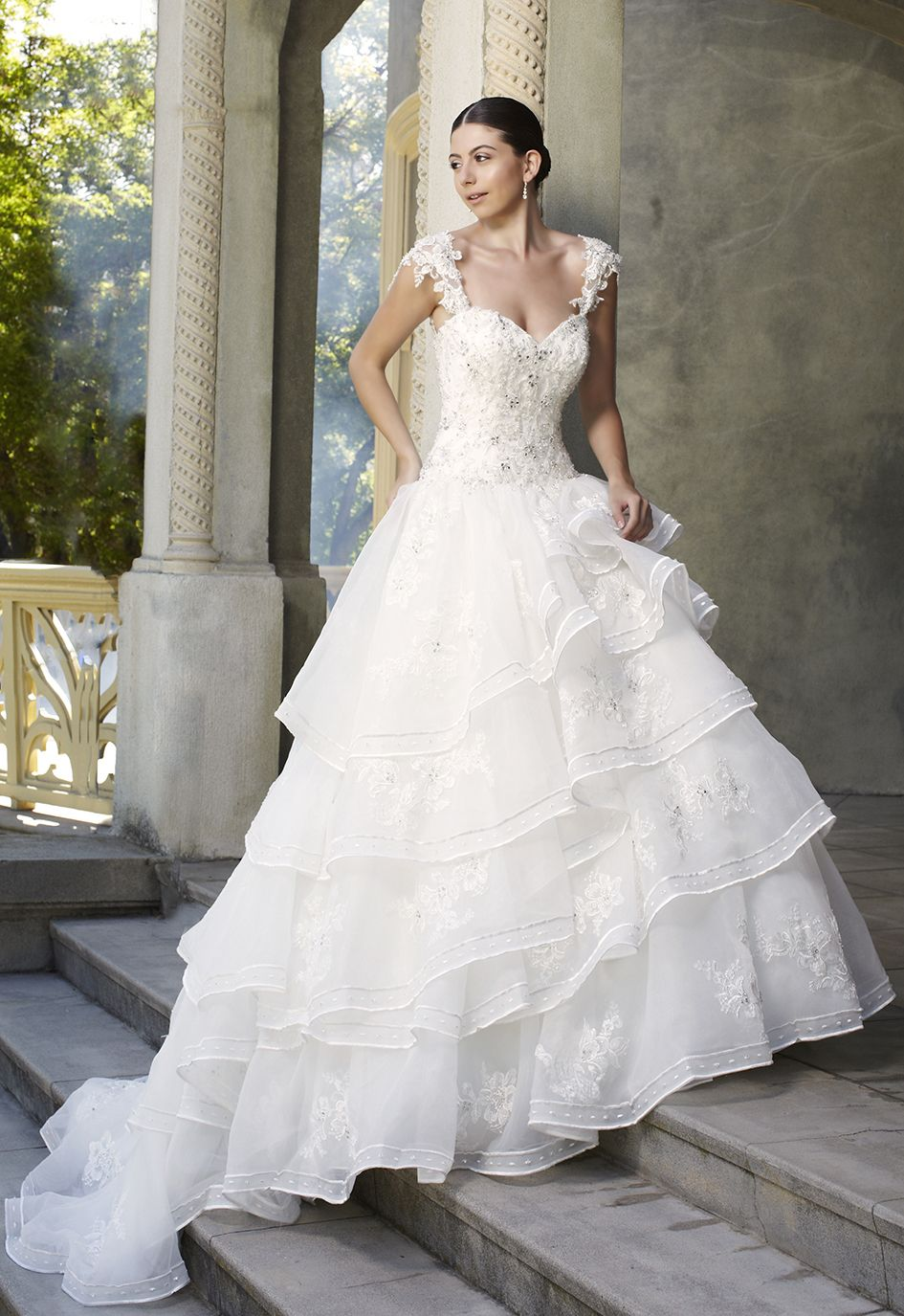 Big pretty wedding dresses  Detailed lace appliques from its cap sleeves through out this