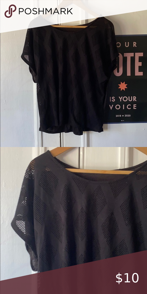 Chic black top with diamond cutouts. Size M.