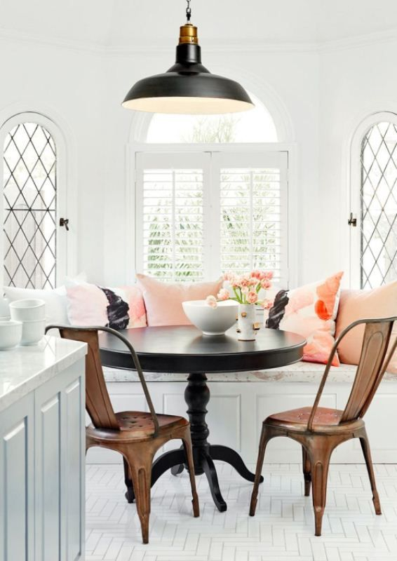 brown classic wooden chairs and black round table for breakfast nook