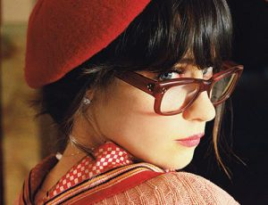 Snow Day with Zooey.  Beret, glasses, plaid and a sweater.