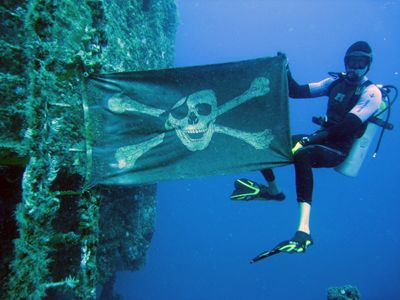 Wreck dive... I don't know where but I love that Jolly Roger!