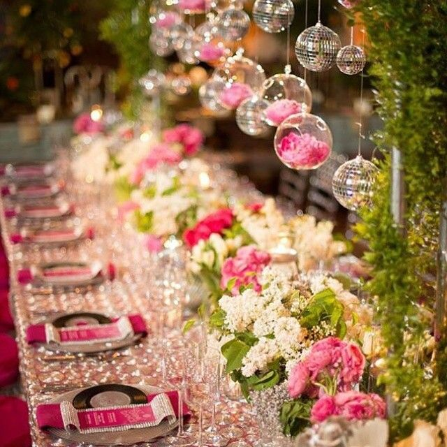 Who would ever thought a glitzy disco theme could make an interesting wedding decoration? Look how cute the hanging disco balls are when combine with pretty flowers! Isn't this decoration fascinating? Tag a friend who'll love this! Photography by @joel_studioemp / Decoration by @kelseyevents