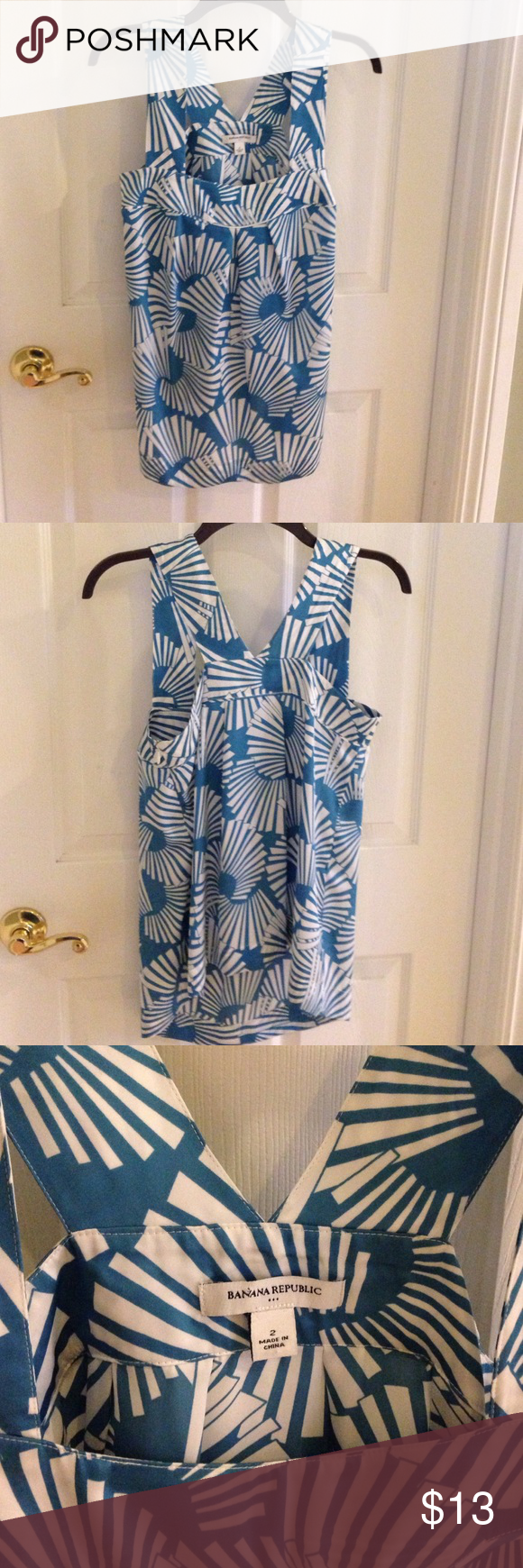 Summer blouse banana Republic Gorgeous blue and white sleeveless summer blouse made out of a soft cool polyester fabric.  Very easy care Banana Republic Tops Blouses