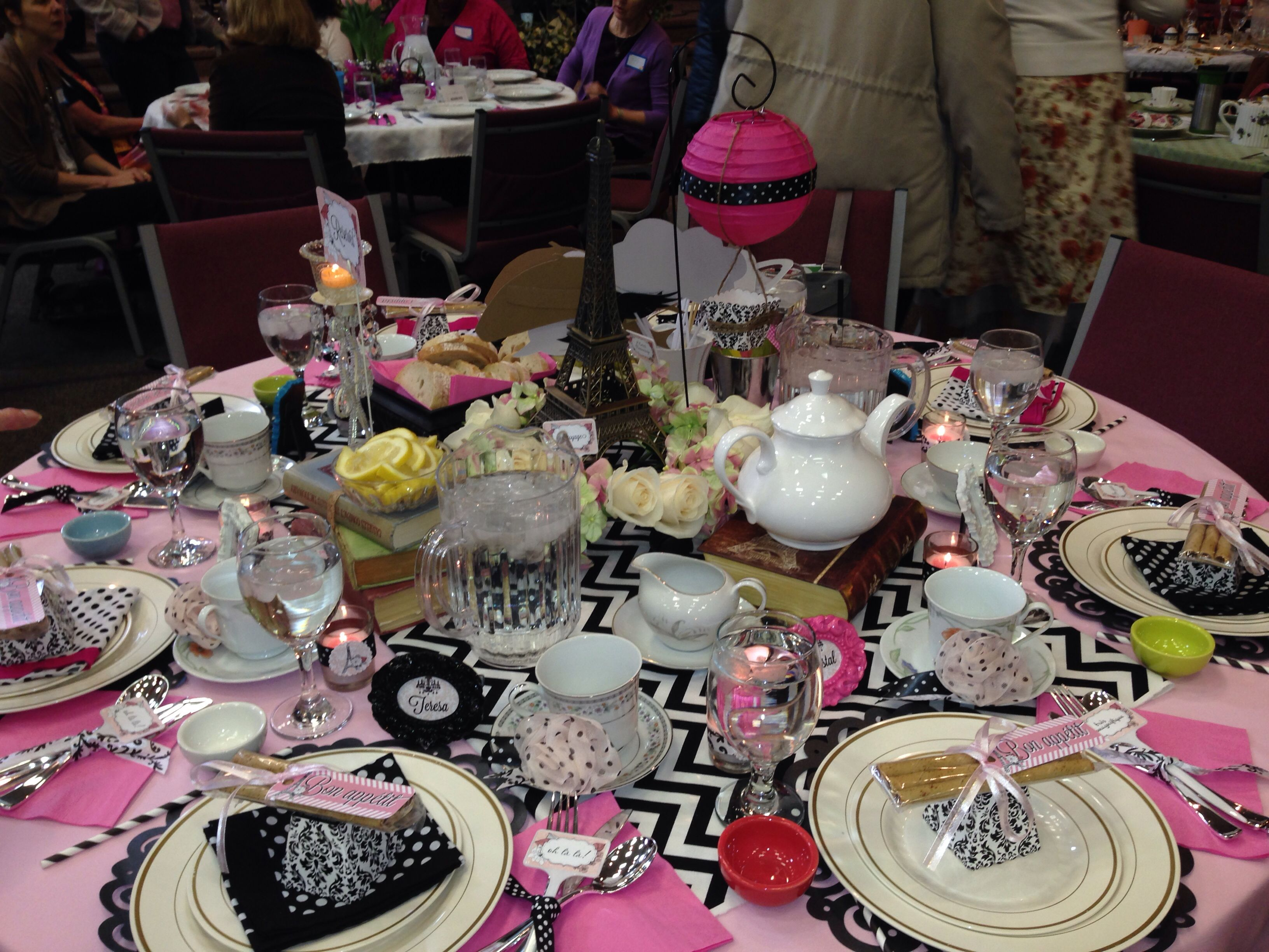12 paris themed table for womens tea party event at church tables