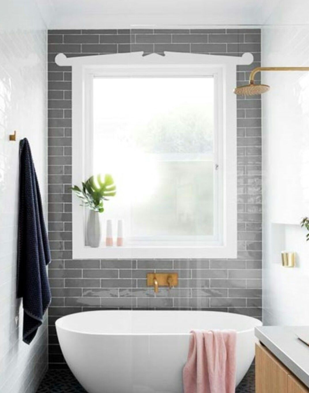 Grey subway feature tiles around bathroom window | Bathroom ...