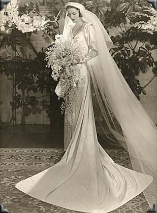 This Photo Is From The 1930s And Features A Bride In Her Wedding Gown Extra Long Veil