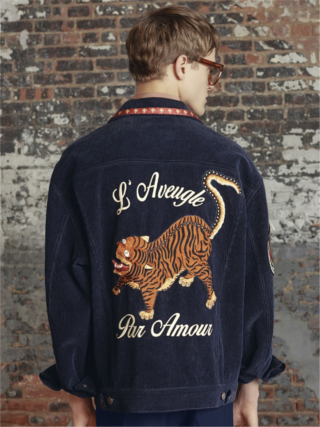 75df61dc4 Gucci's oversized blue velvet corduroy jacket with multiple embroideries  and appliqués.
