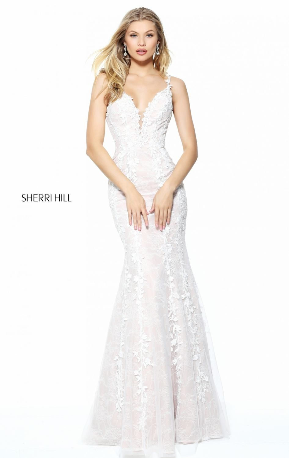 Let all eyes be on you in Sherri Hill 50938. V-neckline with sheer inset at center front flatters your best asset. Lace appliques festooned the entire outfit from the top cascading down the full length hemline.