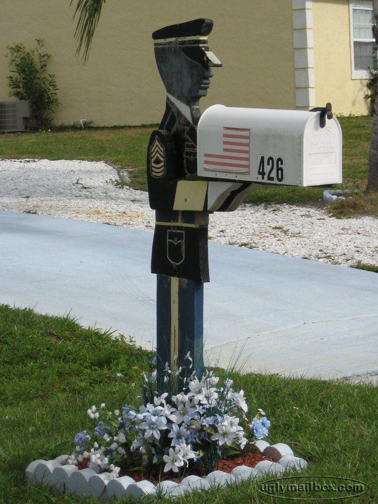 Uniformed Man holding Mailbox