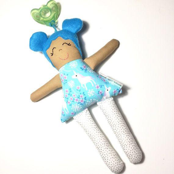Sweet little blue haired Binky Buddy in her unicorn dress. She has an  elastic loop fc03085bb78
