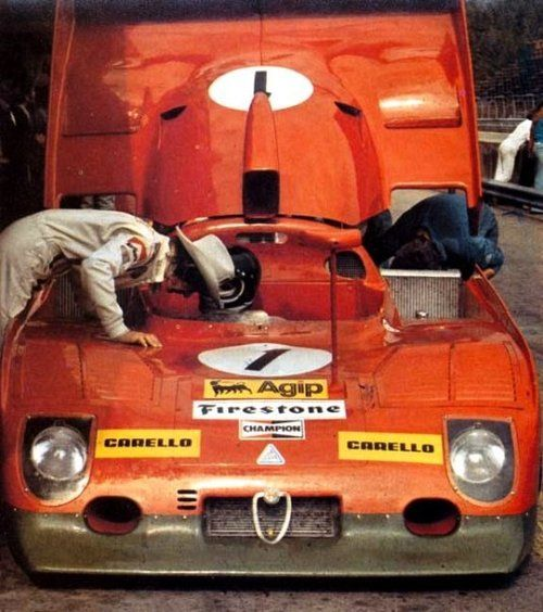 itsawheelthing:  talk to the cowboy …Jacky Ickx talking to his team mate, Arturo Merzario, Alfa Romeo TT33/TT12, 19741000km Österreichring, ZeltwegIckx would set the fastest lap during the raceat 1:35.810 or 222.102kph